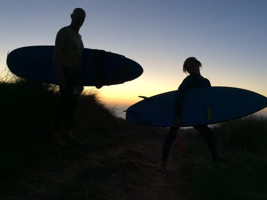 Polzeath, UK: Dad and son getting surf training together
