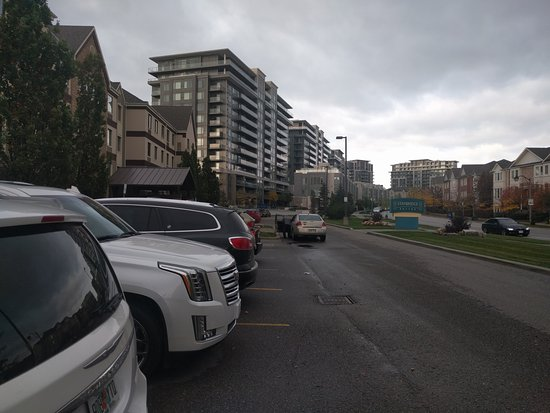 Front of hotel & parking, next to/opposite nearby condo residences on South Park Road