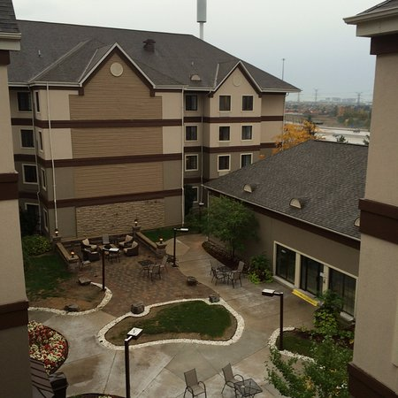 View from our 4/F suite into the open courtyard below - traffic on 407 Hwy in the background