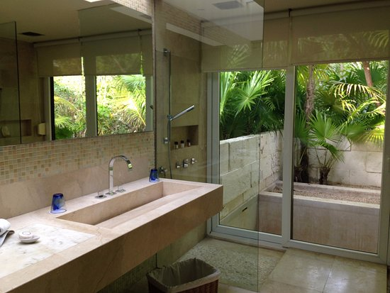 double glassed rain shower opening into outdoor bathtub - Picture of ...