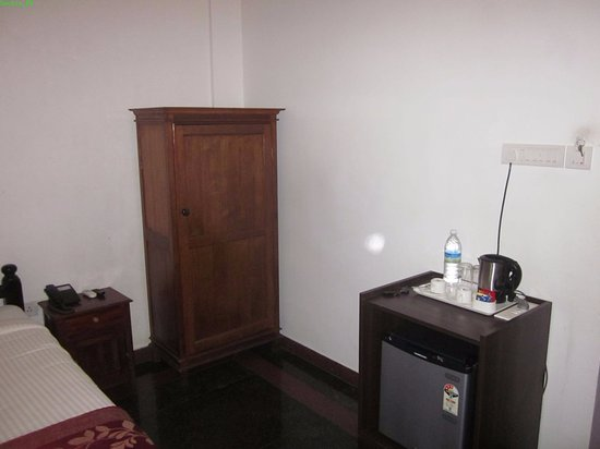 Delicieux Hotel Bon Sejour: Wooden Cupboard, Mini Fridge And Hot Kettle Etc. Optimum