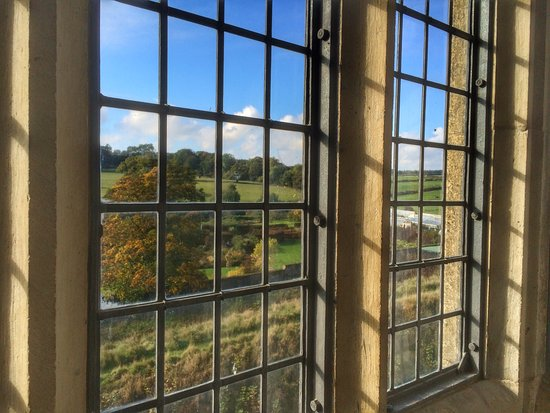 Helmsley, UK: View of the Walled Garden through a castle window.