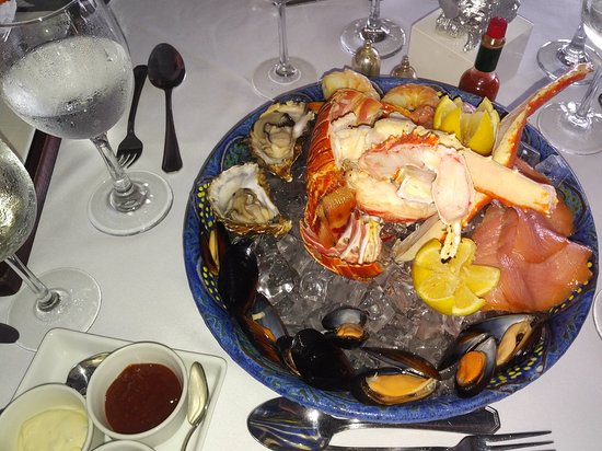 Holetown, Barbados: Seafood Platter, whole lobster, 2 x Oysters, King Crab leg, smoked salmon, mussels and 3 dips