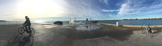 Cobourg Beach: Beautiful in the morning. Check out that spray at the end of the wharf!