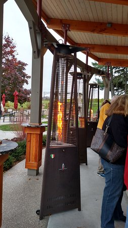 Suttons Bay, MI: Heaters around the outdoor bar