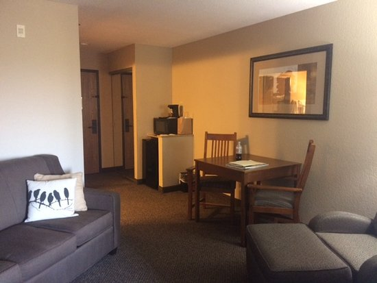 Comfort Inn & Suites Blue Ridge: King Suite / couch, chair, table and micro/fridge area.
