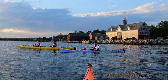 Paddlers off on an evening paddle along Shelburne's historic waterfront.