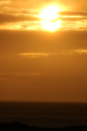 Ocean Shores, WA: Direct view of the surf/sunset from our balcony...