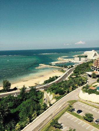 Kafuu Resort Fuchaku Condo Hotel: アネックス棟の最上階にあるインフィニティプール