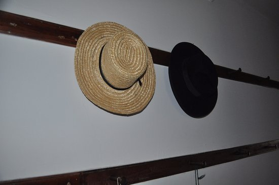 Pittsfield, MA: Men's hats hanging in a hall of the Brick Dwelling. (Women's hats are on the opposite side.)