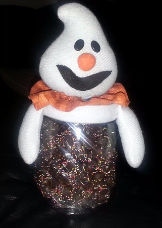Affy Tapple: a ghost on a mason-type jar for Halloween filled with chocolate-covered pretzel nuggets