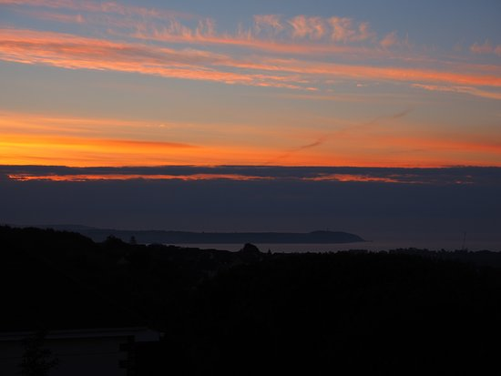The Lookout Guesthouse: Sunrise over St Austell Bay, from 'The Sea'