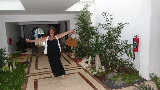Ambrosia Hotel: me in hall way where they brought the garden in on top floor