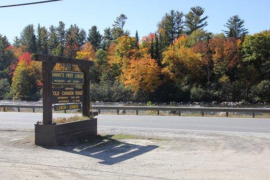 West Forks, ME: Sign on highway of Hawk's Nest Restaurant & Pub