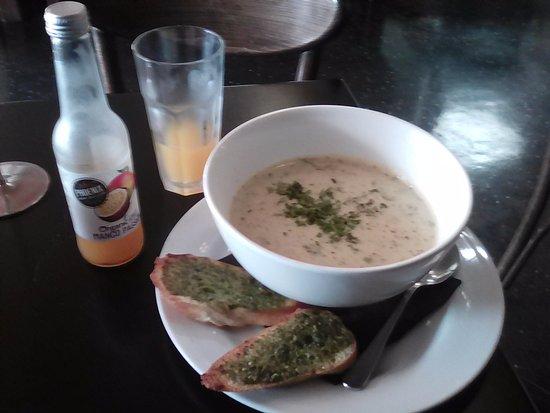 gusto sea food chowder and garlic bread the drink mango was
