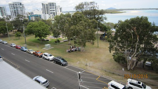 Space Holiday Apartments : From balcony, down to front street and Cotton Tree Park, ocean in background.