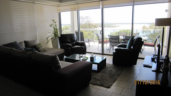 Space Holiday Apartments : View from kitchen area, lounge, towards balcony. Comfy leather recliner lounges.