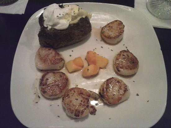 Martinsburg, WV: Pan Seared Scallops, baked potato with butter and sour cream, and chopped mango.