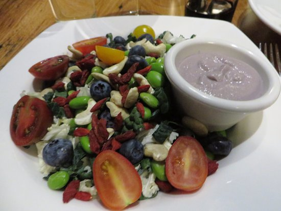 Niwot, Colorado: Kale salad with blueberries, edamame, cashews and tomatoes
