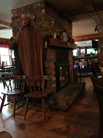 Moultonborough, NH: fireplace and Halloween decorations