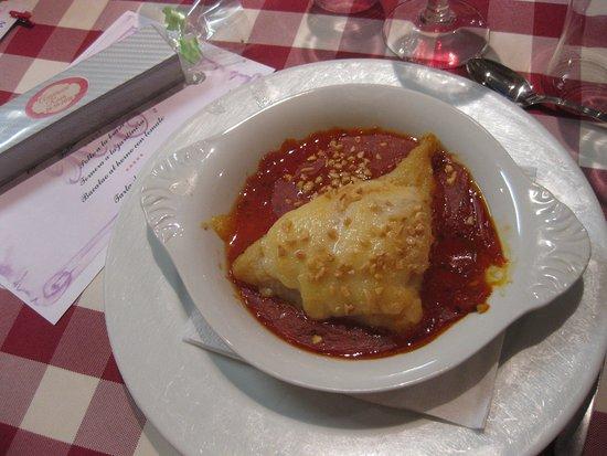 Este es el bacalao con salsa de tomate.