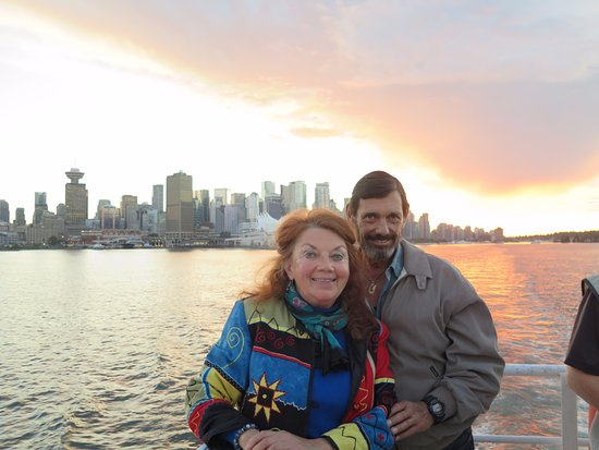 Cookie and Keller enjoy a stroll on the deck as the sun sets aboard Harbour Cruises.