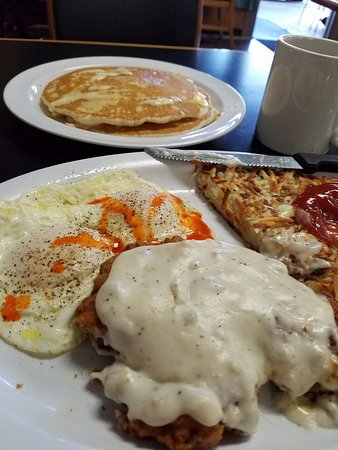 Santee, CA: Chicken fried steak, eggs over easy with my added hot sauce, hash browns and pancakes.  All deli