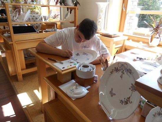 Herend Porcelanium: Final touches are put on an exquisitive plate.