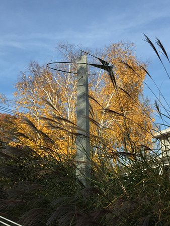 Mermaid Inn of Mystic: View from hammock of David Smalley sculpture and towering white birch.