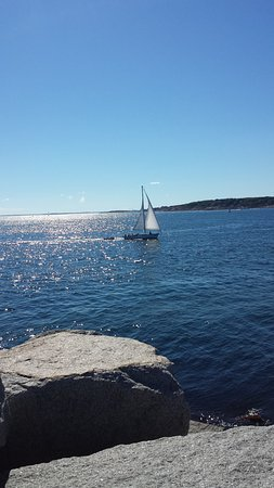 Eastern Point Lighthouse: Sailboat gliding around Gloucester