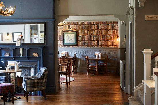 Sticklepath, UK: Cedars Refurb Tables With Library Wallpaper