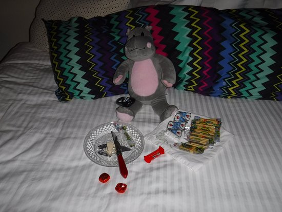 Palace Hotel & Bath House Spa: This is Po enjoying the complementary mini bar snacks.