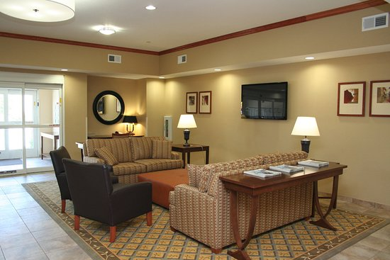 Avondale, LA: Inviting hotel lobby with comfortable seating and style.