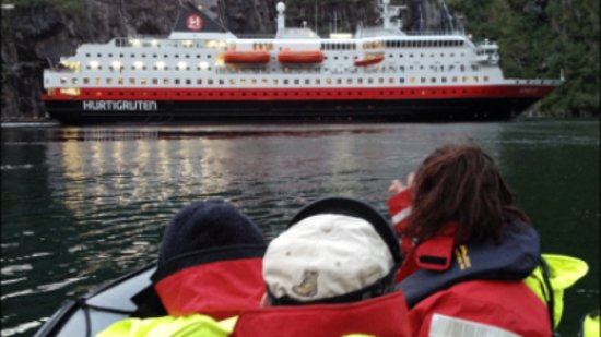 Melbu, Norway: Meet the «Hurtigruten» inside the Troll Fjord.