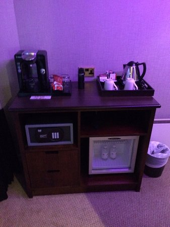 Abbey Hotel Closet Area With The Safe Coffee Maker Kettle And Fridge