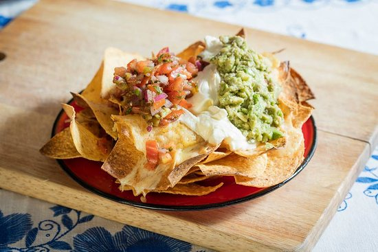 Nachos Melted Jack cheese house made guac salsa and sour cream
