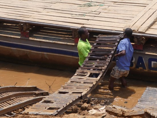 Belo Tsiribihina, Madagascar: Preparing to load vehicles on the barge to cross the Tsiribihina River.
