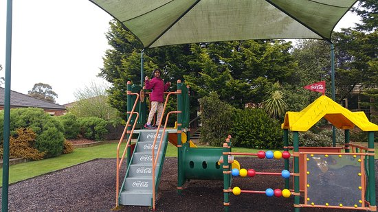Country Club Villas: Kids play area and golf course