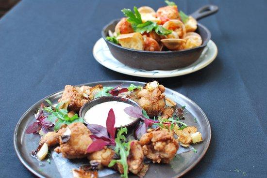 husk restaurant garlic fried bull frog legs clams in garlic and tomato both