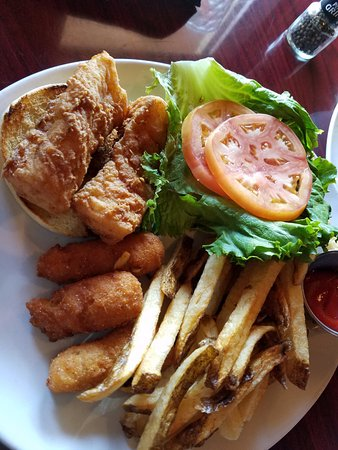 Riptides: Fried cod sandwich with hush puppies and fries.