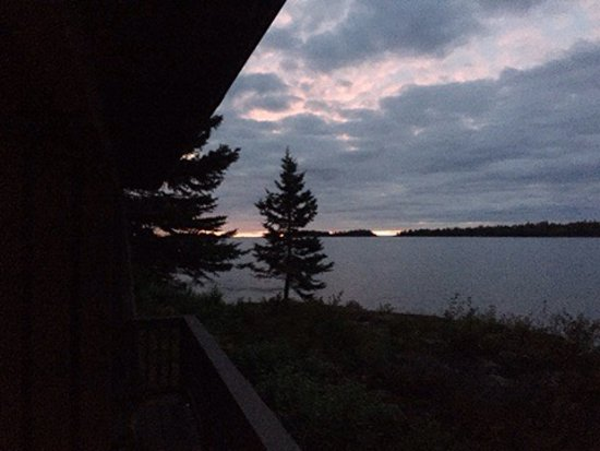 Isle Royale National Park, MI: Moose visits the Rock Harbor Lodge. Sunrise view from a guest room in the Rock Harbor lodge.