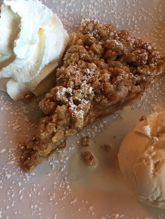 Claudio's Restaurant: The dining room and apple crumble a la mode