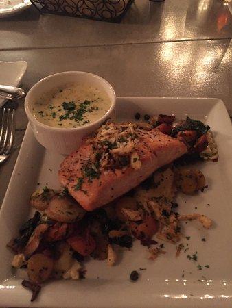 Delicious salmon with lump crab, over portobello stuffed ravioli w/sauce requested it be on side