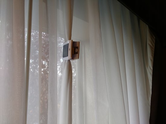 Holiday Inn Express & Suites: Chip clip holding the curtain together