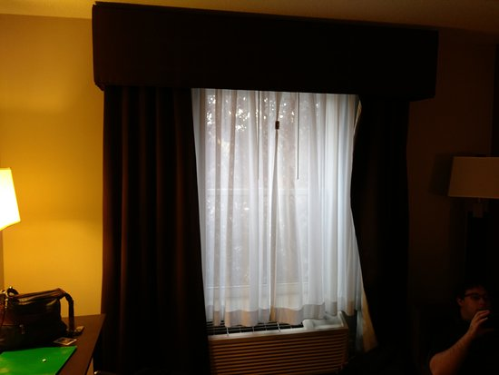 Holiday Inn Express & Suites: Sheers with thick drape frame. No blackout shade or curtain here. Sheers complete with chip clip