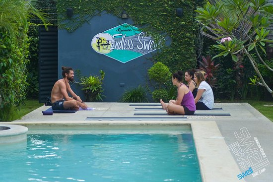 Swell Surf Camp: Yoga classes by the pool. Definitely do these!