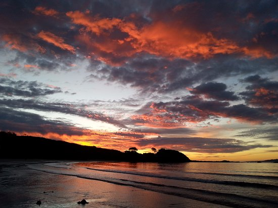 Mangonui, Nueva Zelanda: Sunset at beautiful Coopers Beach