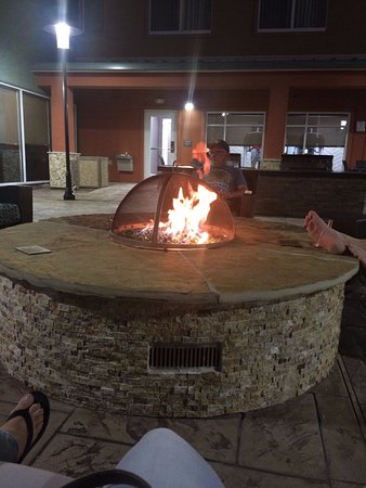 Pasadena, TX: Fire pit with 2 BBQ grills in the background