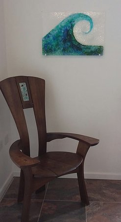 Mullion, UK: Oak chair made by Roskillys fine furniture with glass panel by Zoe Schoning.