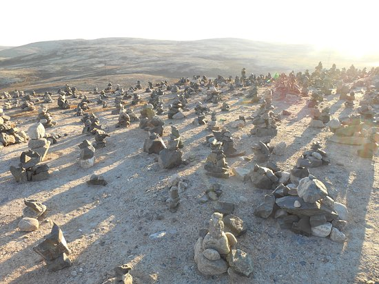 Murmansk Oblast, Russia: stones that are stacked in heaps on the way there